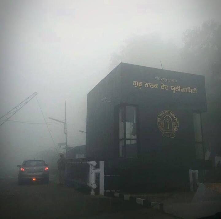Guru Nanak Dev University gate in foggy morning
