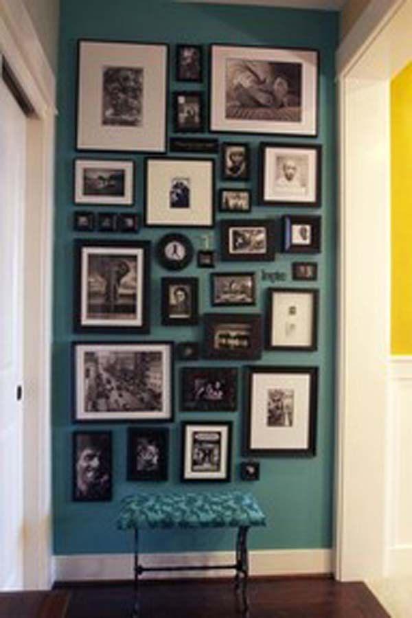 Black & white prints on teal wall