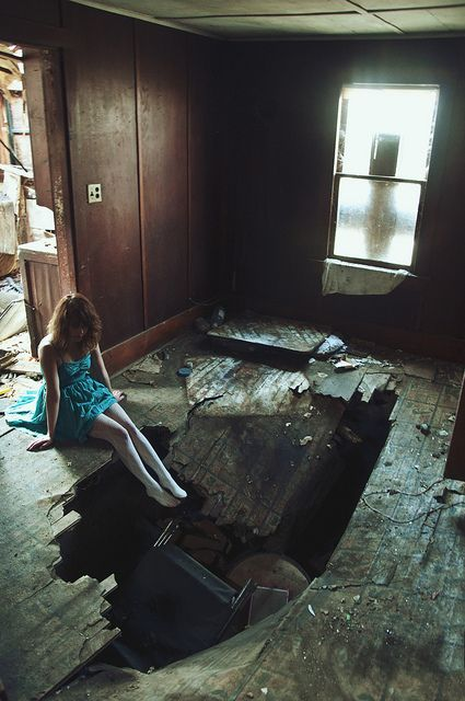 They had made a mess, when they came for him. He had obviously put up a good fight and lost. She, however, just sat there. Not fighting, not speaking, barely even breathing. Just staring. Staring into the vast hole that had been made in the floor. The vast hole paralleling the one made in her heart. A big dark, empty space which something or someone used to inhabit.
