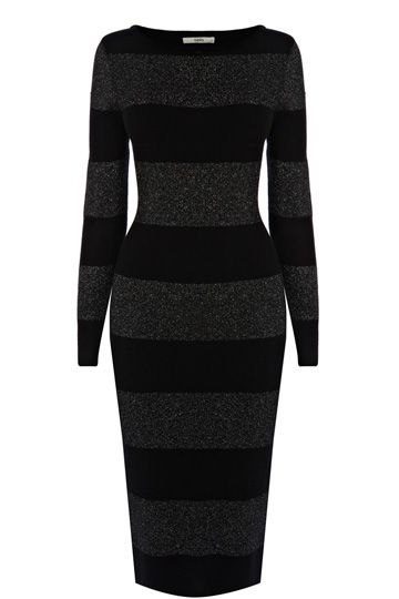 Our must have knitted dress of the season has been given a festive update with wide sparkle stripe detailing across the fabric. The piece features long sleeve styling and a scooped neckline.