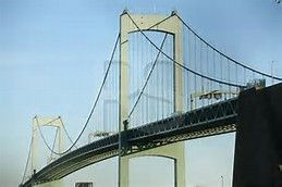 The Walt Whitman Bridge is a green-colored single-level suspension bridge spanning the Delaware River from Philadelphia to Gloucester City, in Camden County, New Jersey, United States. Named after the poet Walt Whitman, who resided in nearby Camden toward the end of his life, the Walt Whitman Bridge is one of the larger bridges on the east coast of the United States. The bridge is owned and operated by the Delaware River Port Authority. Construction on the bridge began in 1953,[1] and it…
