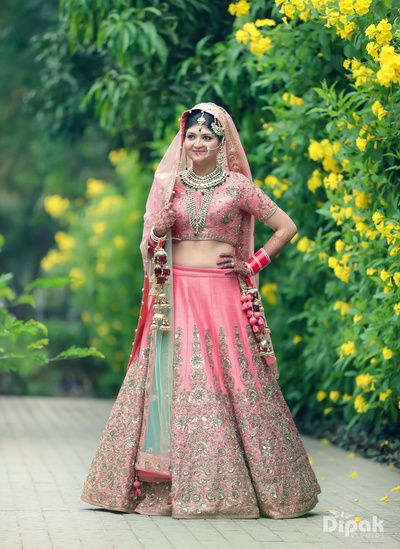 Bridal Wear - Pink Bridal Wedding Lehenga | WedMeGood | Pink Lehenga with Gold and Silver Embroidery and Green and Pink Net Dupatta #wedmegood #indianbride #indianwedding #lehenga #pink #embroidery #bridal #dupatta #weddinglehenga