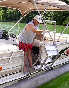 The Tooner II pontoon boat ladder is designed with three wide plank steps in a staircase alignment and double fold down step. Durable, safe pontoon ladder. #boataccessories