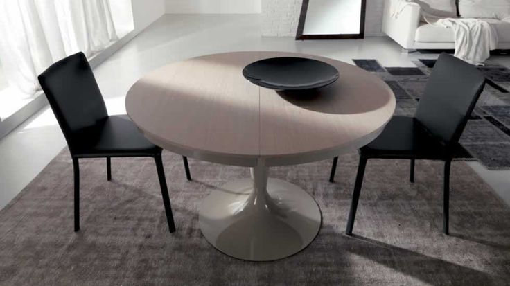 ECLIPSE LEGNO, design: Studio Ozeta - Extendable dining table with metal central column, wooden top and inside extension. www.ozzio.com