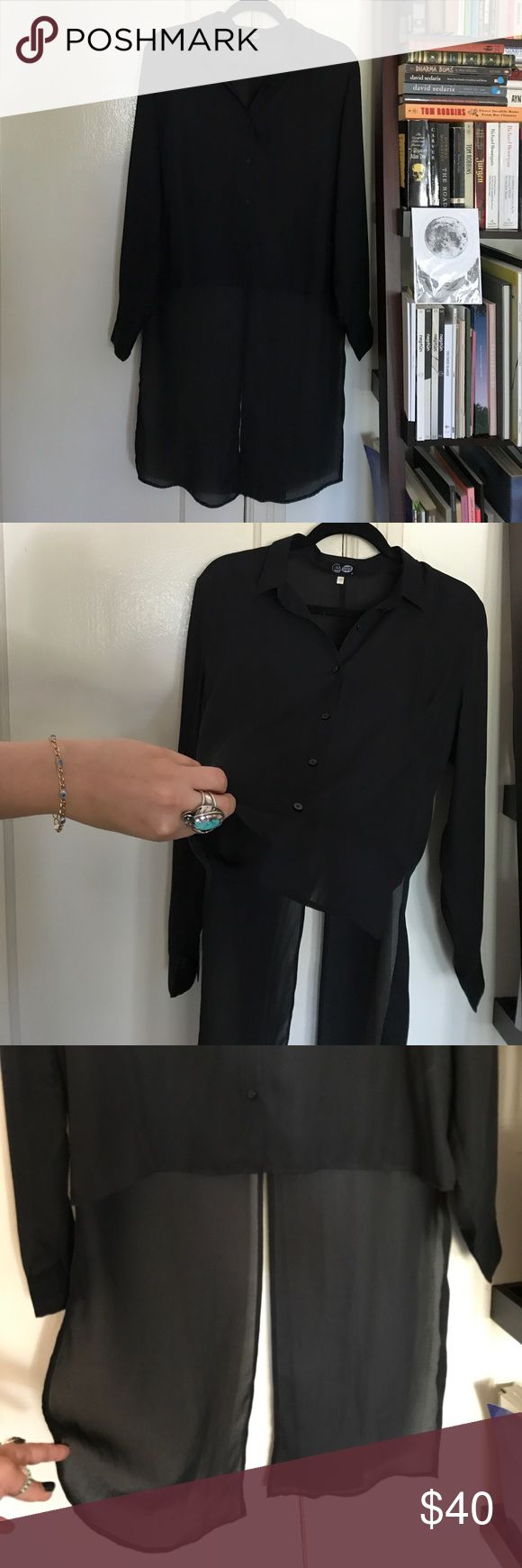Unique Black button up Top This is truly a unique piece. This is a sheer black long sleeve button up top. The front is cropped shorter than the back- perfect for tucking in or wearing as is. The back is longer and has a high slit- looks awesome when you walk ;) This pairs really well with a pair of denim shorts or some high waisted denim. Brand is Cheap Monday but purchased at Urban Outfitters years back. Urban Outfitters Tops Button Down Shirts