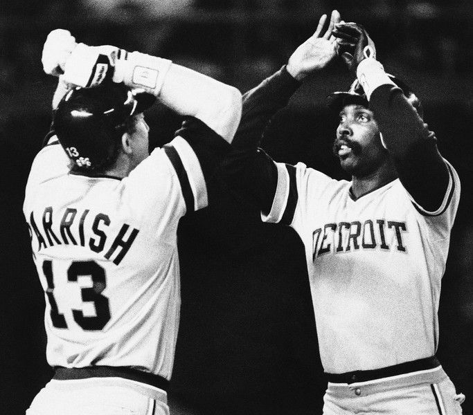 Game 1 WS - Detroit Tigers catcher Lance Parrish congratulates Larry Herndon in the Tigers 3-2 victory over the San Diego Padres in the opening game of the World Series, Tuesday, Oct. 9, 1984 in San Diego. (AP Photo)