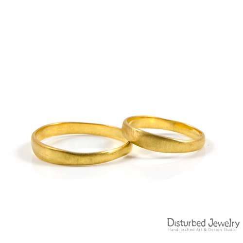 ' Gold is the traditional metal for wedding rings, which symbolize the union of two people ' Custom Irregular Wedding Rings / Crafted out of 14 Karat yellow #gold. We design your one-of-a-kind jewelry for a lifetime. #customweddingbands #customjewelry #customweddingrings #weddingrings #disturbedjewelry #weddingjewelry