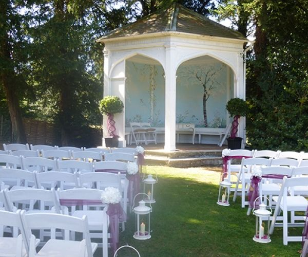 An outdoor wedding ceremony at Wasing Park in Berkshire