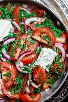 Mediterranean Herb Tomato Salad   The Mediterranean Dish. Tomatoes and red onions with lots of parsley and dill, doused in citrus and olive oil. Top it with feta! Click the image to get the recipe and follow TheMediterraneanDish.com for more!