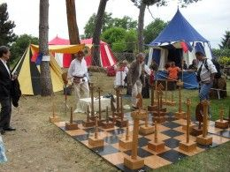 Playing medieval games at a medieval party. this site has a dance video and other links
