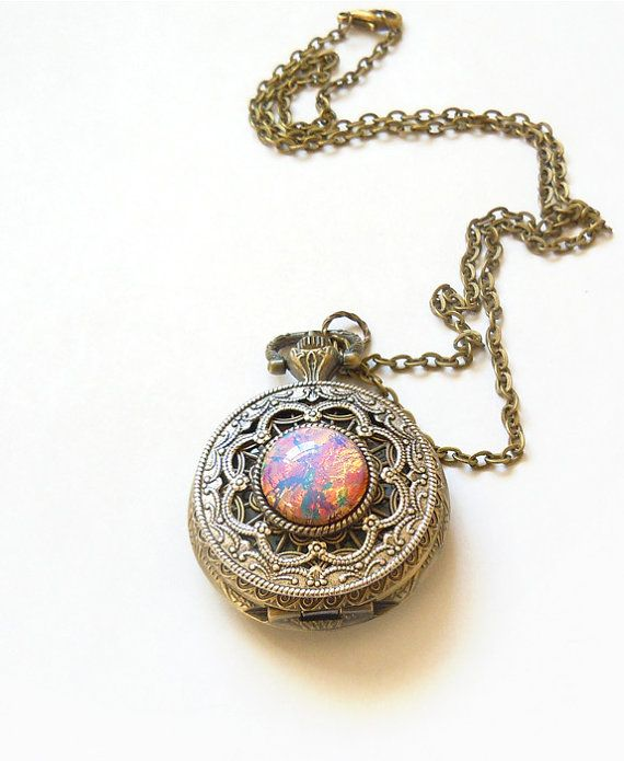 Pink  Fire Opal Pocket watch Locket style by TwilightsCastle, $55.00. I WANT!!!!!!!