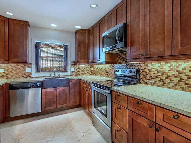 Craftsman Kitchen with Craftsman Panel Cabinet Door, High ceiling, Peppercorn White Quartz Countertop, limestone tile floors