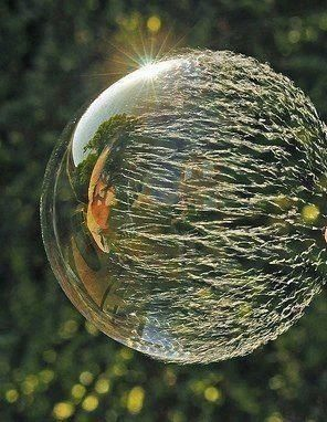 When a Bubble begins to burst. Put camera on tripod, do this at a sunset so bubbles are well lit, and set shutter speed high