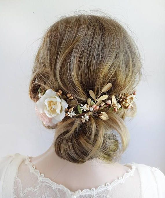 A luxe embellished hair vine to nestle above your updo or half-up hairstyle. A cluster of cream and blush roses offset to one side, with a bit of lace. The length of vine is adorned with interwoven budding vines, golden flowers and foliage. Finished with exquisite pearl details. Length