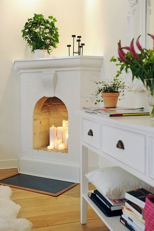 Fake white limestone corner fireplace