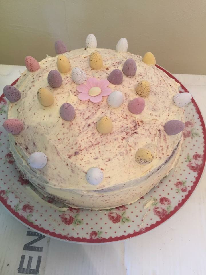 Red velvet sponge with cream cheese butter cream. Decorated with mini eggs. Made from scratch.