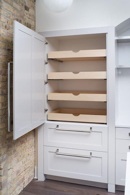 Fabulous Kitchen Features Concealed Pantry Cabinets Fitted With Stacked Pull Out Drawers Next To An Exposed