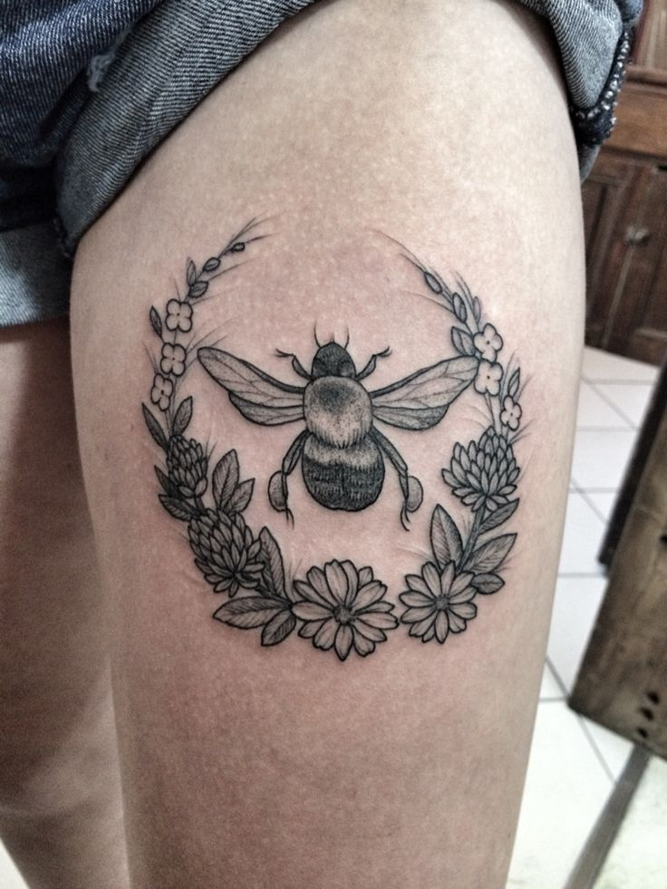Bumble bee and wreath tattoo. By Jennifer lawes - Pearl Harbor gift shop, Toronto.