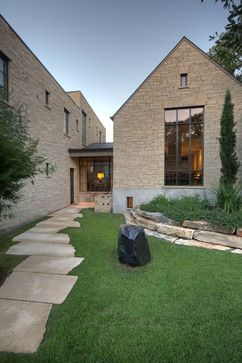 Pecos Side Exterior - traditional - exterior - austin - stone and steel windows Hugh Jefferson Randolph Architects says:  The stone pathway, and the house stone, are texas gray lueders limestone. The pathstone is on a gravel & sand base. There is no mortar on the pathway.