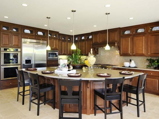 Eat-In Kitchen: A fan-shaped island provides a roomy space for informal dining. From HGTVRemodels.com
