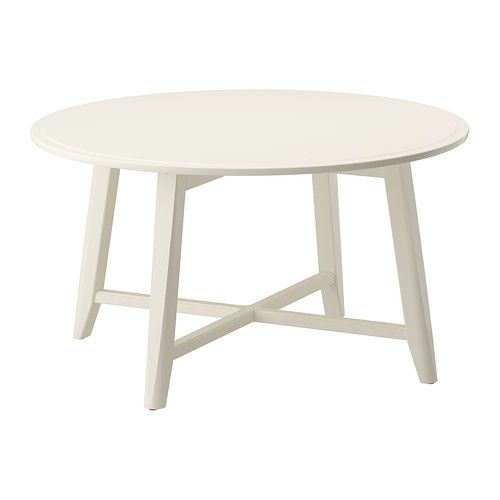 IKEA - KRAGSTA, Coffee table, white, , The round shape gives you a generous table top for trays, coffee or tea services. The dimensions make the table easy to place in the room. The table legs are made of solid wood, a durable, natural material.The included plastic feet protect the floor from scratches.