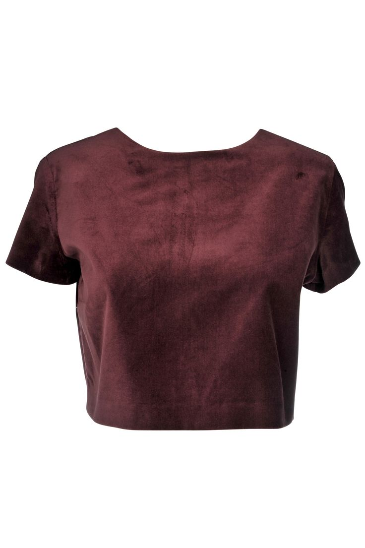 Velvet look fabrics are in, and with velour fabric, long sleeves and a cropped to show off your midriff this velour crop top is the perfect way to update any girls wardrobe. Pair with a skirt and heel
