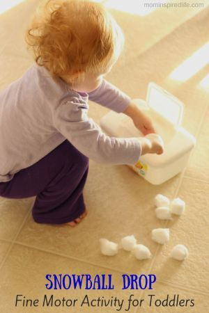 This fine motor activity for toddlers brings the winter fun indoors! Toddlers will explore the texture of the cotton balls while developing fine motor skills.
