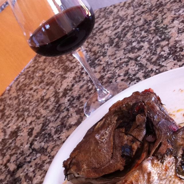 Strange food pairings...oven baked fish head and Port wine