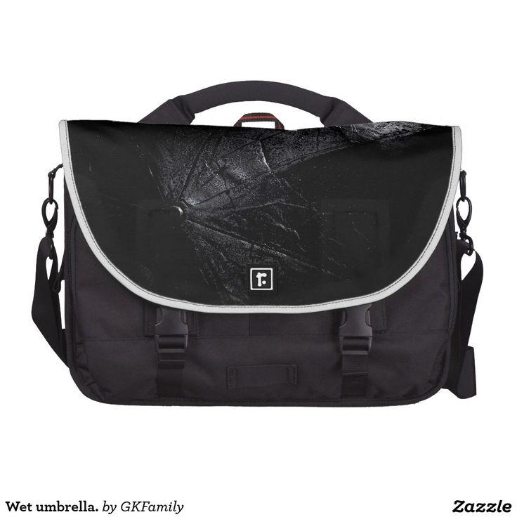 Wet umbrella. laptop commuter bag