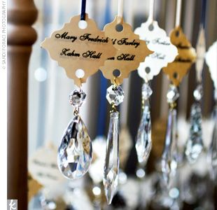 Escort cards with chandelier crystals-love this idea..can be turned into a holiday ornament as a memento of the wedding..