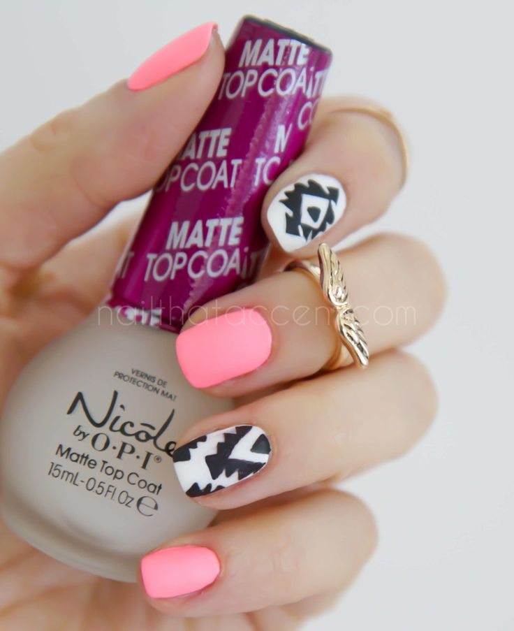 I wanna try this: Neon, Tribal Nail, Matte top coat....maybe just not all at once. And I love that cute ring.