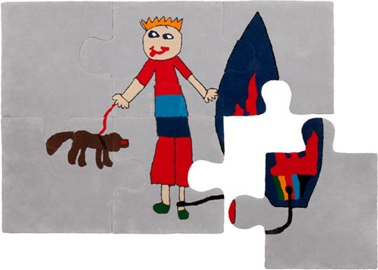 Su dibujo en una alfombra-puzzle...