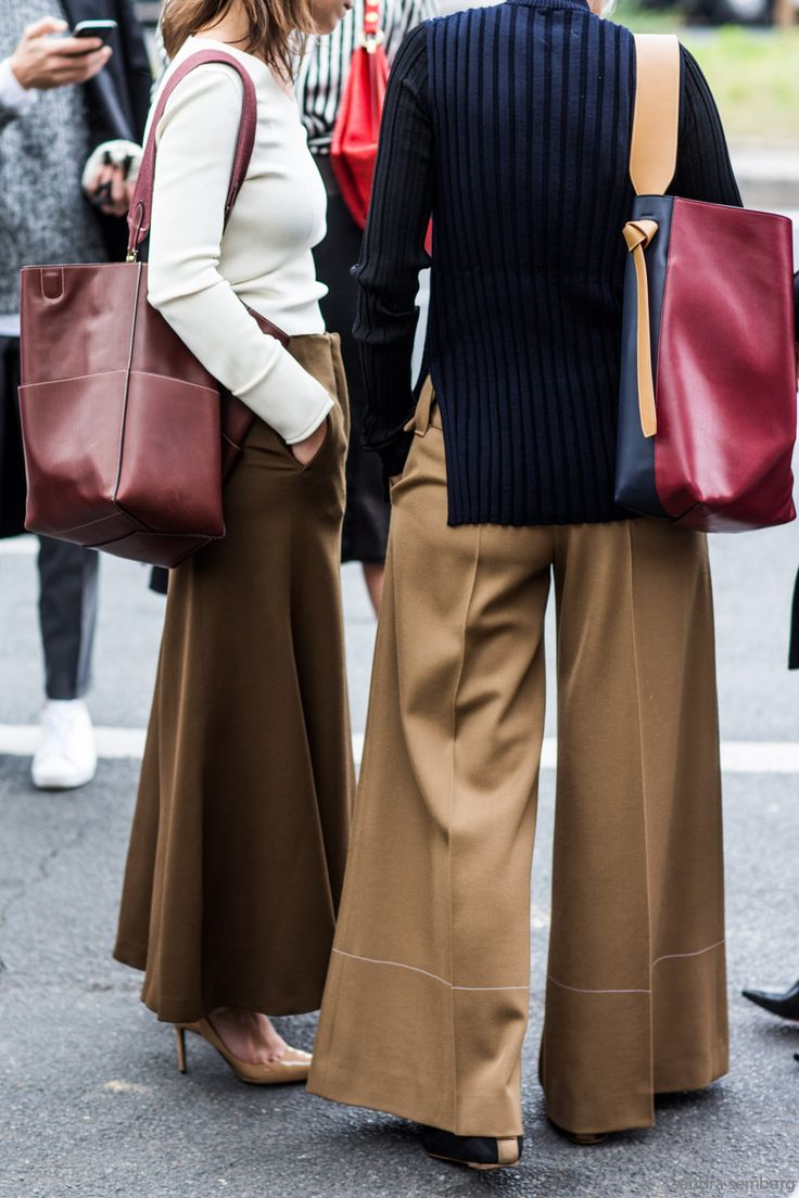 Large wide legged pants and earthy hues paired with large shoppers