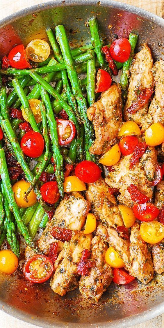 OnePan Pesto Chicken and Veggies – sundried tomatoes asparagus cherry tomatoes. Healthy gluten free Mediterranean diet recipe with basil pesto.