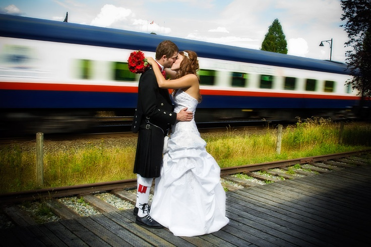 Bride and Groom kiss as train speeds past
