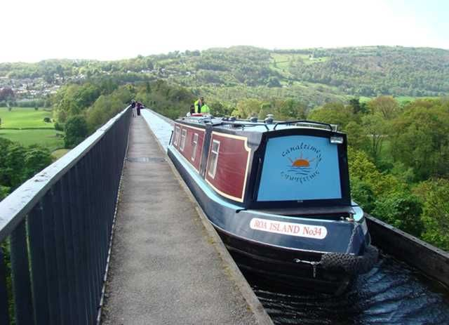 "pont cysyllte aqueduct, telford's welsh canal, llangollen, wales. trough holding the water is 7' wide and can accommodate a narrow boat that is 6'6"" wide. the water extends under the tow path, which would once have carried the large draft horses that pulled these boats."