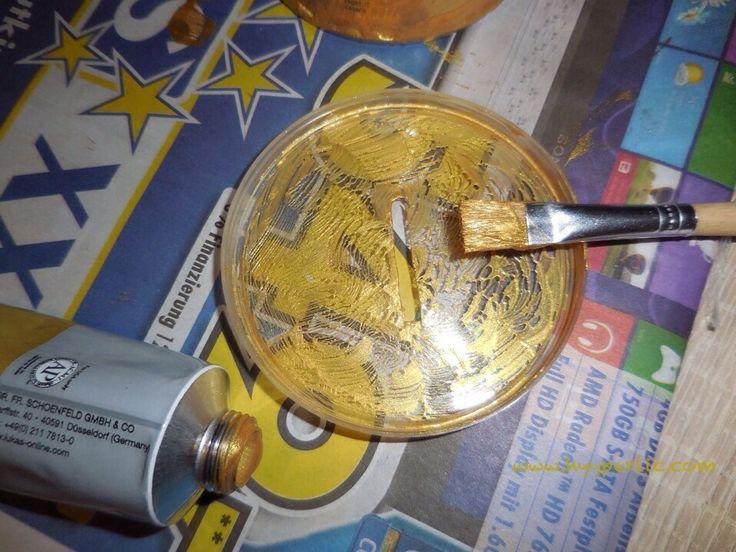 Eine Goldene Spardose kann eine unheimliche Motivation sein da auch aus vielen kleine Stücken einmal große Scheine werden - Einfaches DIY!