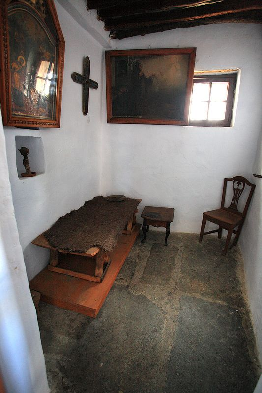 The simplicity of a catholic nun's quarters. There are times when I dream of having a little cottage out in the woods where I can read, think, and write, where the bedroom would look something like this.