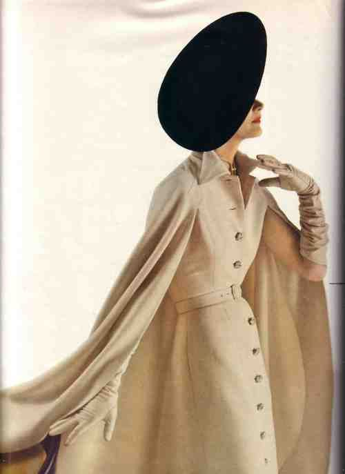 This 50s outfit is classy and sensuous with its great cape look around a stylish coat dress finished with long matching gloves.  Oh, for the good old days?