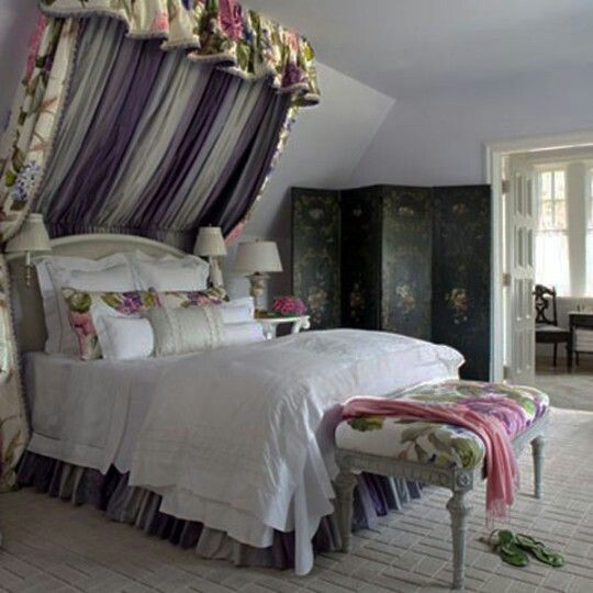 Semi canopy bed with florals sloped ceiling or roof line for Slanted roof bedroom ideas