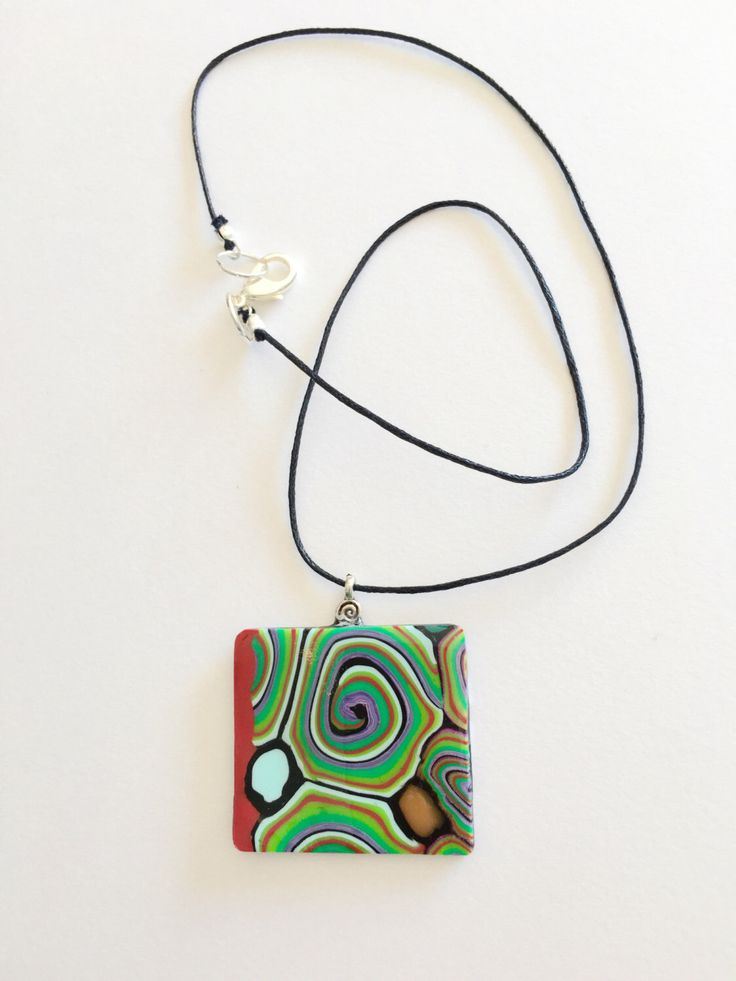 A personal favourite from my Etsy shop https://www.etsy.com/au/listing/401065887/polymer-clay-swirl-pendant