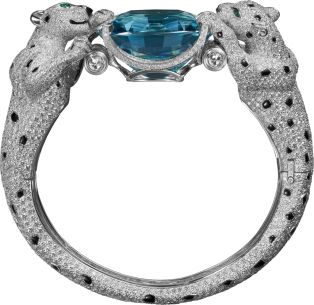 Cartier  Platinum, onyx, emeralds, aquamarine, diamonds