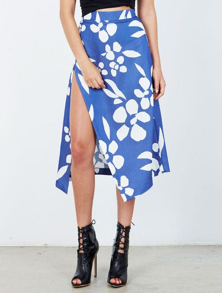 ISLA HUDSON SKIRT from the Tribeca Collection. Sexy, yet demure, this azure floral print midi skirt is incredibly flattering. Cut to sit snugly at the waist this midi skirt falls to create an A-line silhouette, punctuated by a deep thigh split and finished with an asymmetric hem. With a concealed rear zip and hook fastening. Available: www.islalabel.com  #islalabel #fashion #style #winter #skirt #floral #print