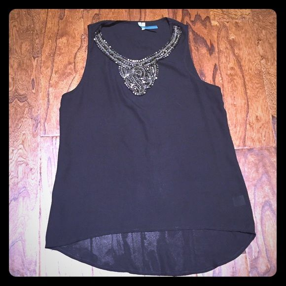 Black Going Out Top Adorable black sleeveless top with dark silver beading at neck. Back is slightly longer. In EUC!  Not sure what original price is - feel free to send reasonable offers using the offer button! Tops Tank Tops