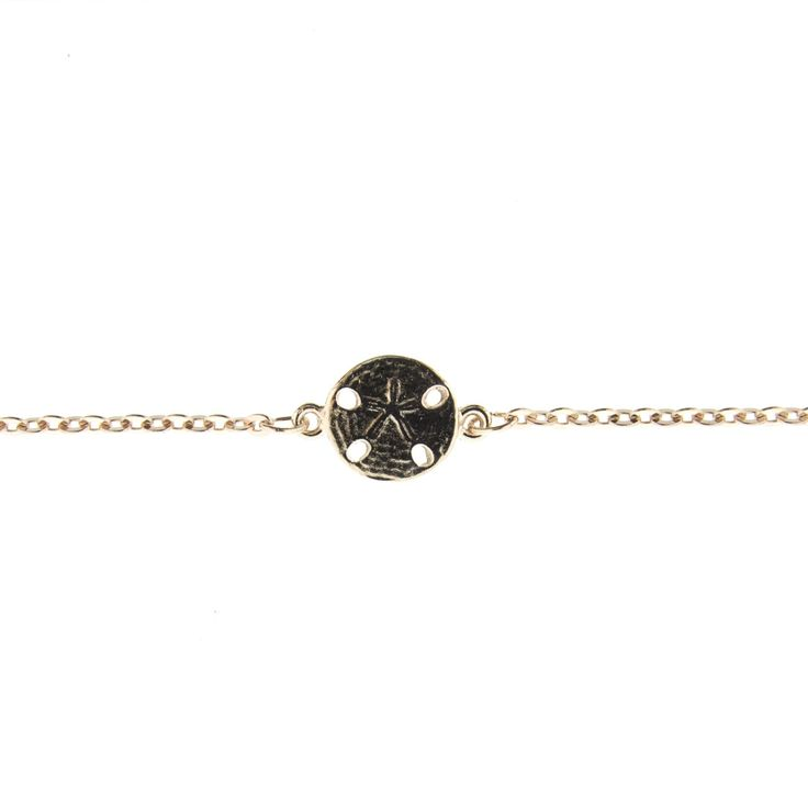Rose Gold Sand Dollar Anklet. Look fabulous in our best-selling anklets. Perfect to wear any time of year! Pairs perfectly at the beach or for a night out on the town. Product Details: 9.5″ Anklet with 1″ Extender Tail. 5/8″ Sand Dollar. Rose Gold Plated over brass chain & white metal charm. Lobster Claw Closure & Made in USA Tag. Made in America with Love. Comes on a R&R Card. Product Care: Store at room temperature, preferably in a jewelry box. Do not wear item in the ocean or shower…