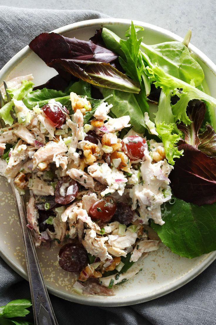 NYT Cooking: A pile of this chicken salad plopped on top of a bed of greens or tucked between two slices of good bread would make a most excellent lunch or light supper.  It starts with a quick dressing made of mayonnaise, chopped chives, parsley and tarragon and the juice and zest of a lemon. Combine the dressing with chopped, cooked chicken (for ease, use supermarket rotisser...