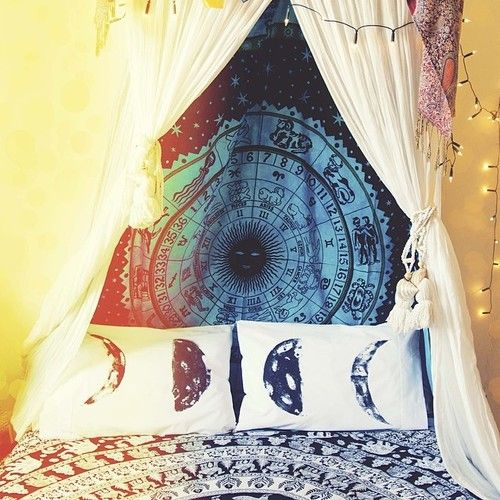 I like the curtains and lights over the bed. also the tapestry behind the bed is a cool idea