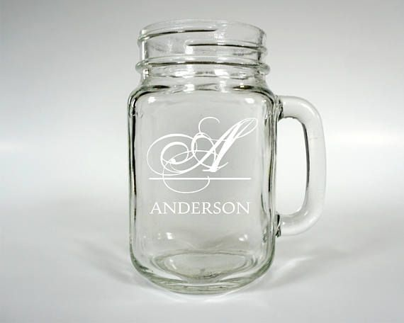 "This Listing is for an unlimited number of mason jar mugs. Perfect for Rustic Barn, Vintage, and Outdoor Weddings. Each mug is fully customizable to fit your wedding details. They look beautiful on the main table and as gifts for the wedding party. Use them for flower girls or ring bearers and fill with candy. Glass 16oz Mason Jars Mugs.  HOW TO ORDER:  To Order, please select the quantity and turnaround service from the drop down menus and then just click the ""ADD TO CART"" button at the top…"