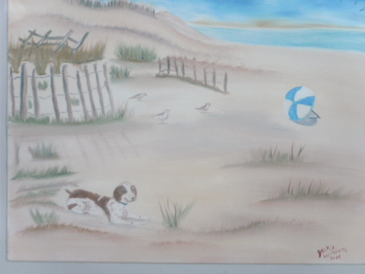 oil painting of a dog on the beach by jackie williams