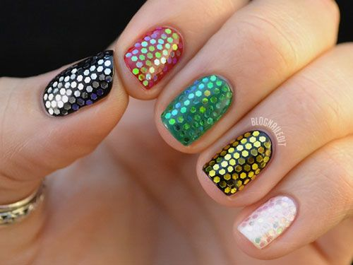 Hexagon Sequins  With a little patience (and a lot of time), you too can achieve this mermaid-inspired manicure from Katy at Nailed It.